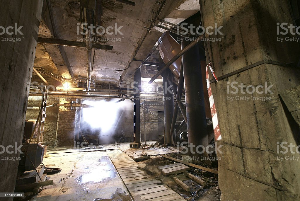 Old abandoned dirty empty scary factory interior royalty-free stock photo