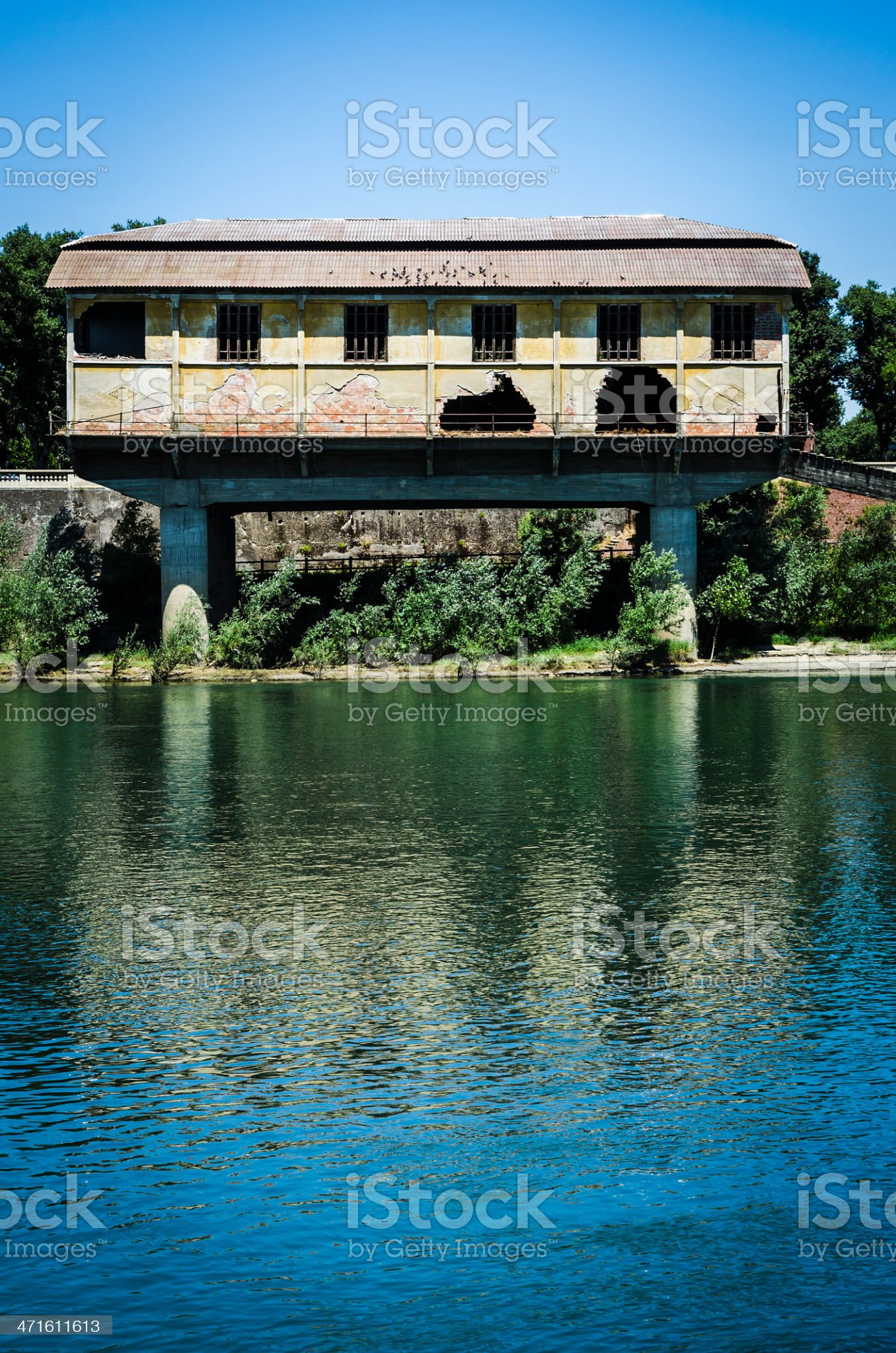 Old abandoned factory on the river royalty-free stock photo