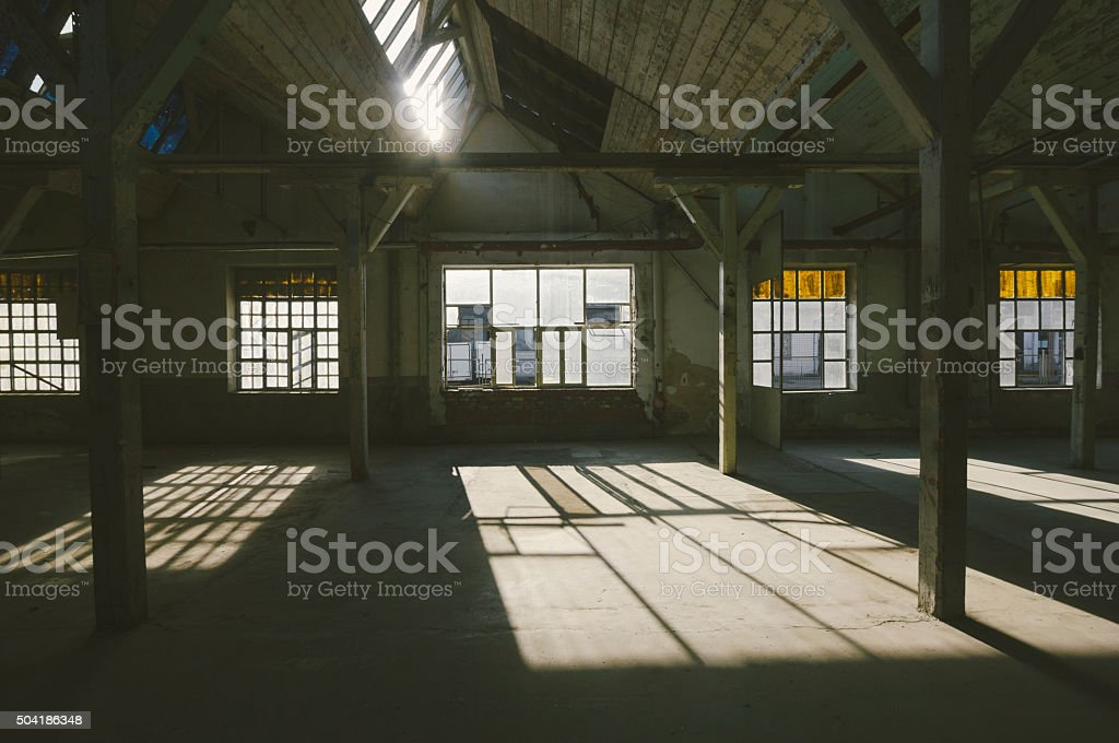 Old, abandoned factory warehouse stock photo