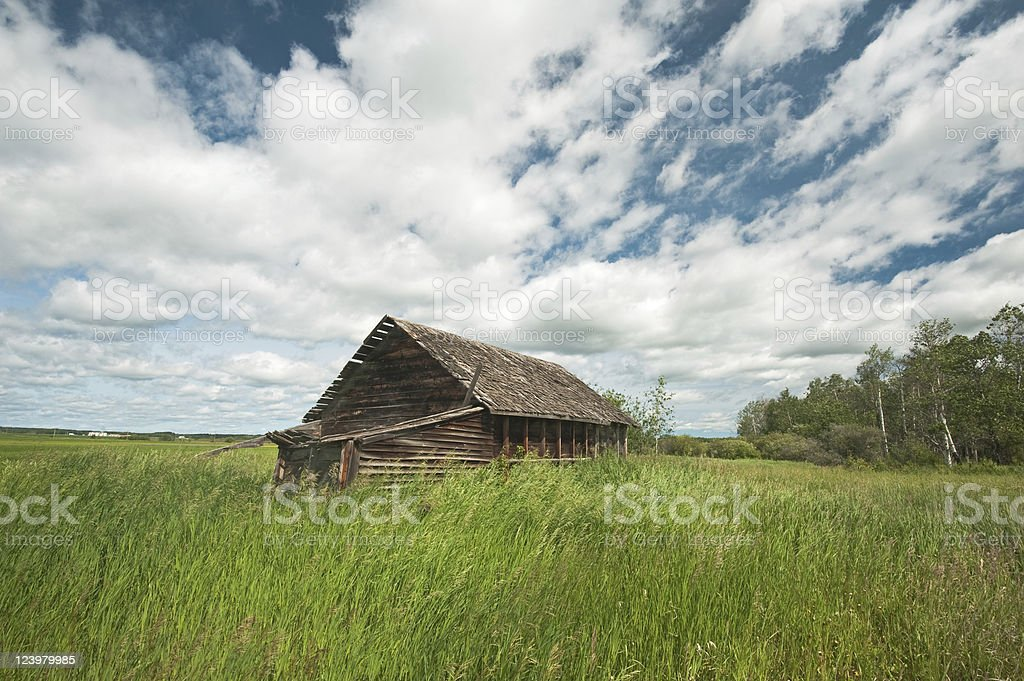 old abandoned far building: derelict wooden house royalty-free stock photo