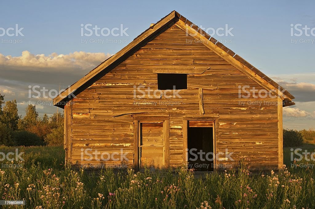 old abandoned farm building: farmhouse at sunset royalty-free stock photo