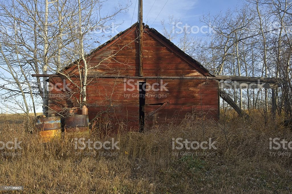 old abandoned farm building: red shed end on view stock photo