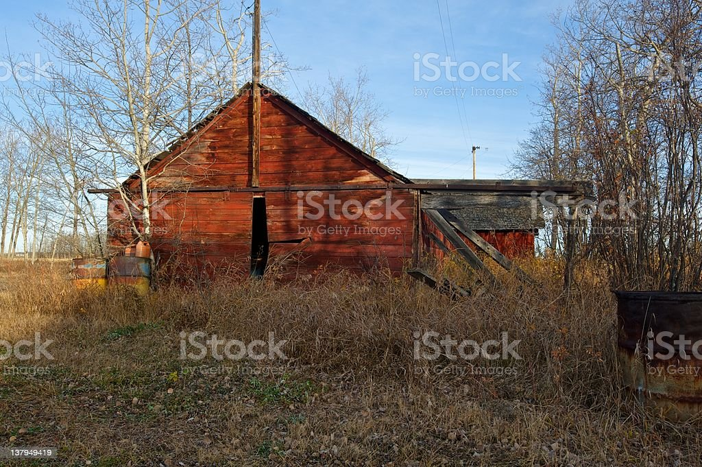 old abandoned farm building: red shed stock photo
