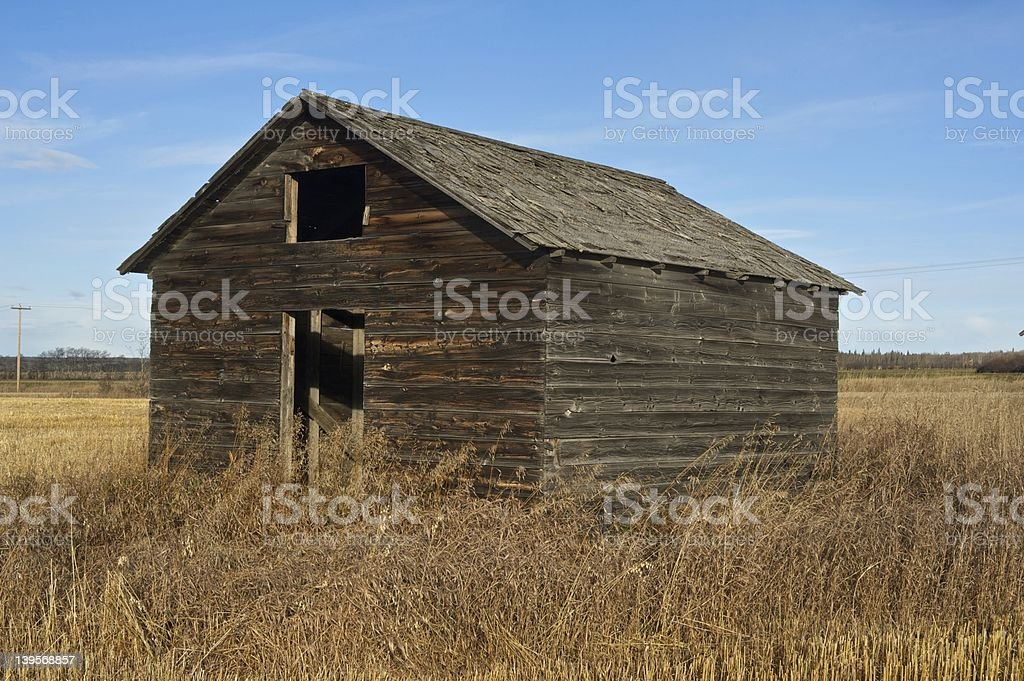old abandoned farm building: wooden granary close view royalty-free stock photo