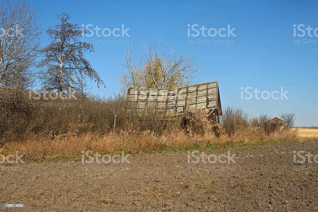 old abandoned farm house: a farmhouse and shed in fall stock photo