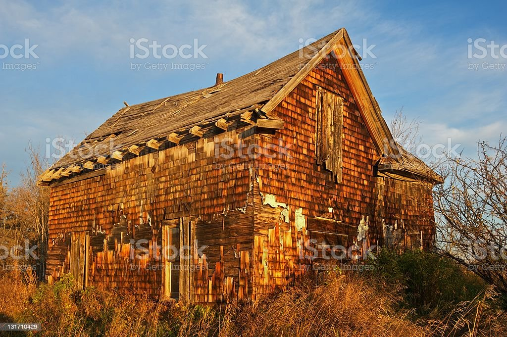 old abandoned farm house: farmhouse at sunrise stock photo