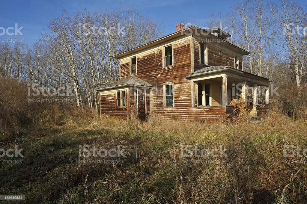 old abandoned farmhouse: decrepit two storey house stock photo