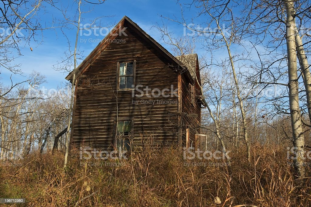 old abandoned farmhouse:  derelict house in aspens royalty-free stock photo