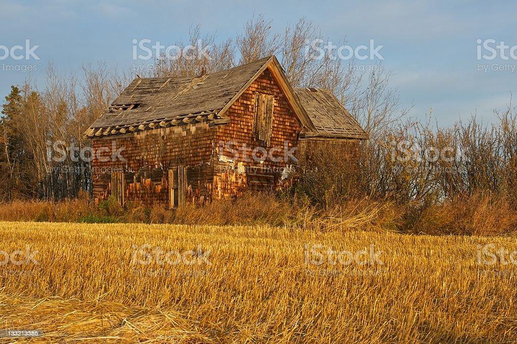 old abandoned farmhouse: farm house on the edge of stock photo
