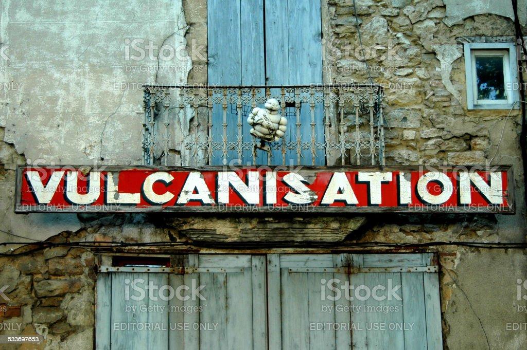 Old abandoned garage in Pont Saint Esprit, France stock photo