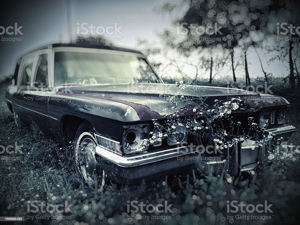 Old Abandoned Hearse in Cemetery stock photo
