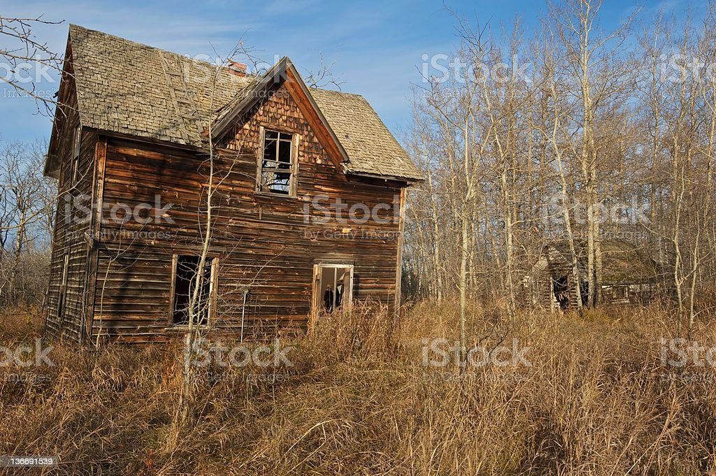 old abandoned house: derelict farmhouse and small shack royalty-free stock photo