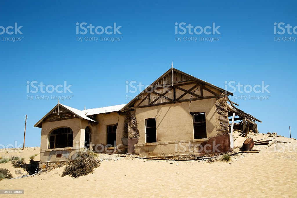 Old abandoned house in the desert stock photo