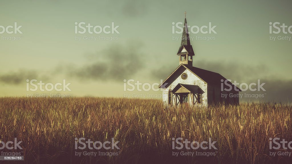Old abandoned white wooden chapel on prairie at sunset. stock photo