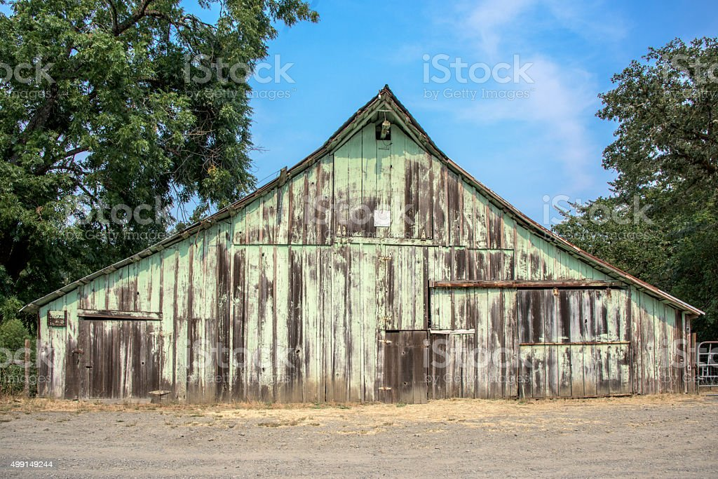 Old abandoned wooden barn facade stock photo