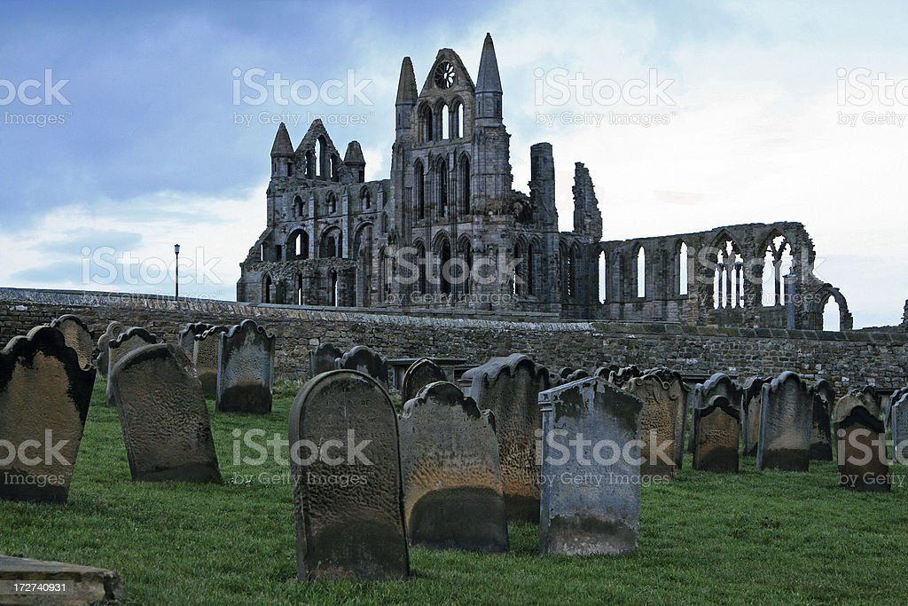 old abbey and graveyard stock photo