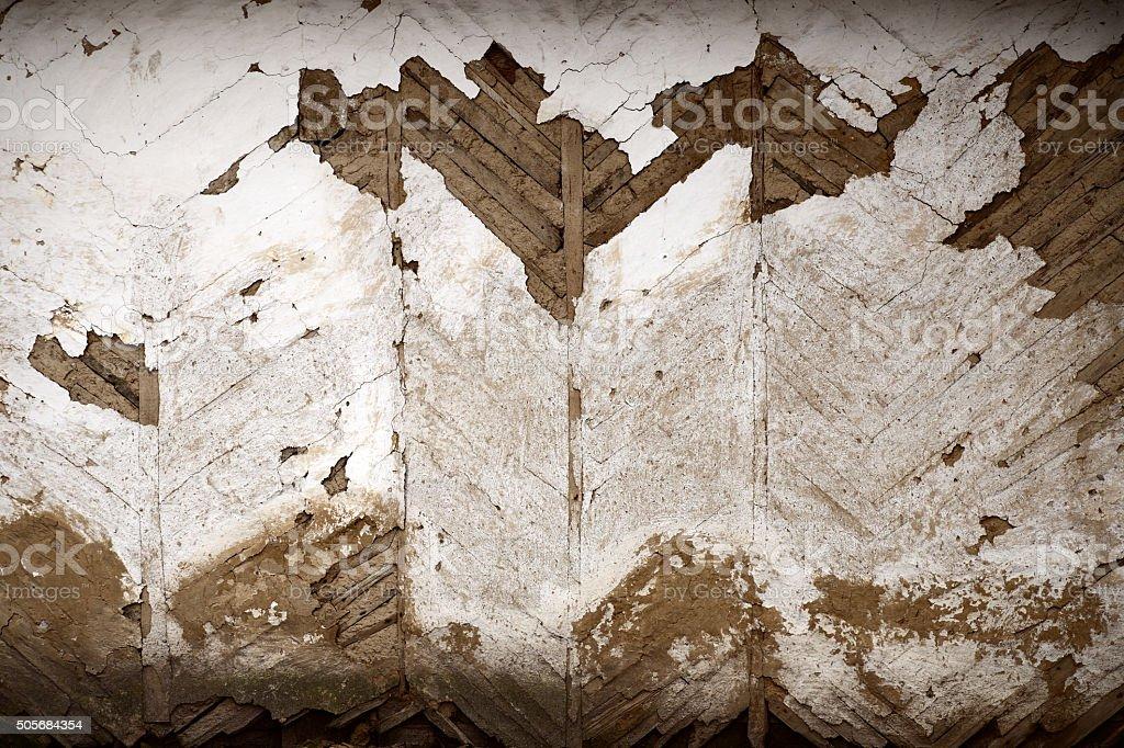 Old adobe wall foliated stock photo