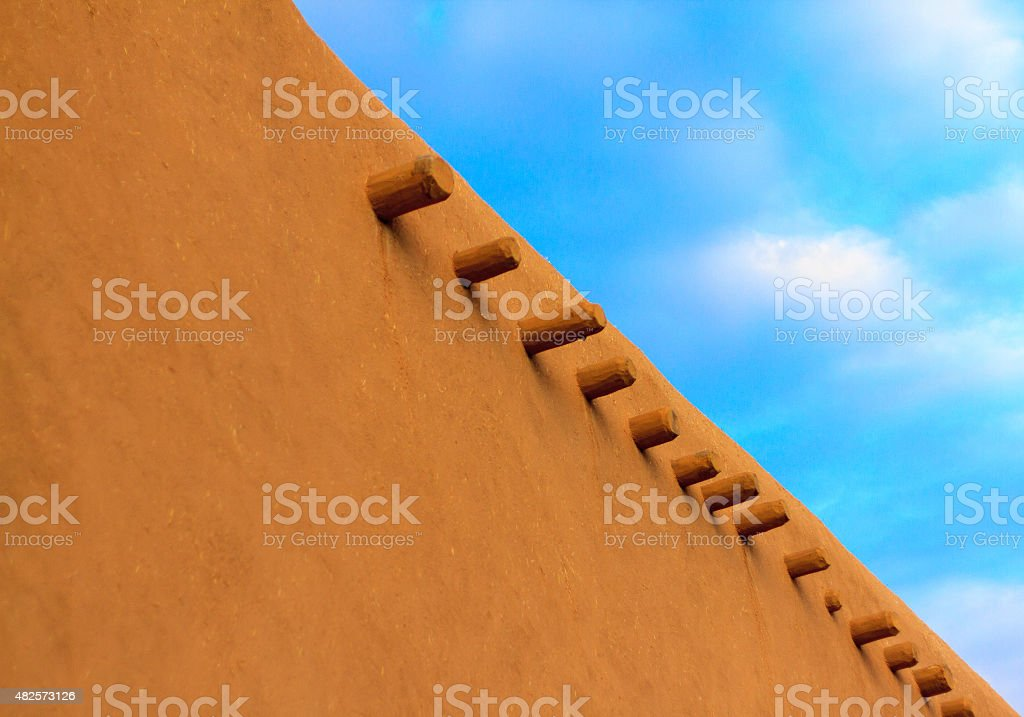 Old Adobe Wall with Vigas, Blue Sky stock photo
