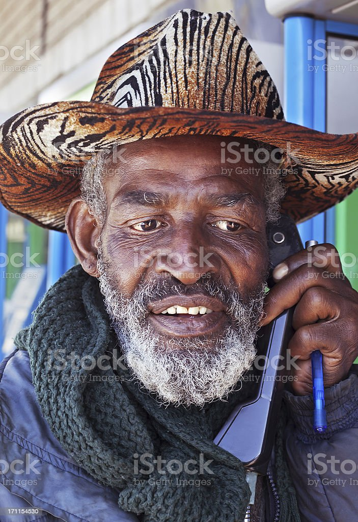 Old African Man on the Telephone stock photo