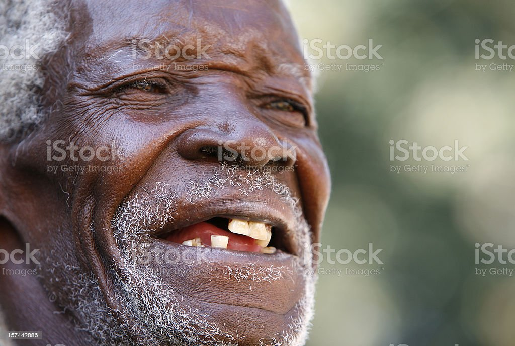 Old African man smiling royalty-free stock photo