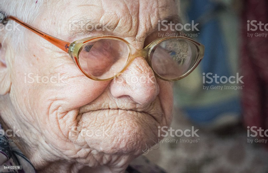 Old age and sadness. Portrait of an elderly woman stock photo