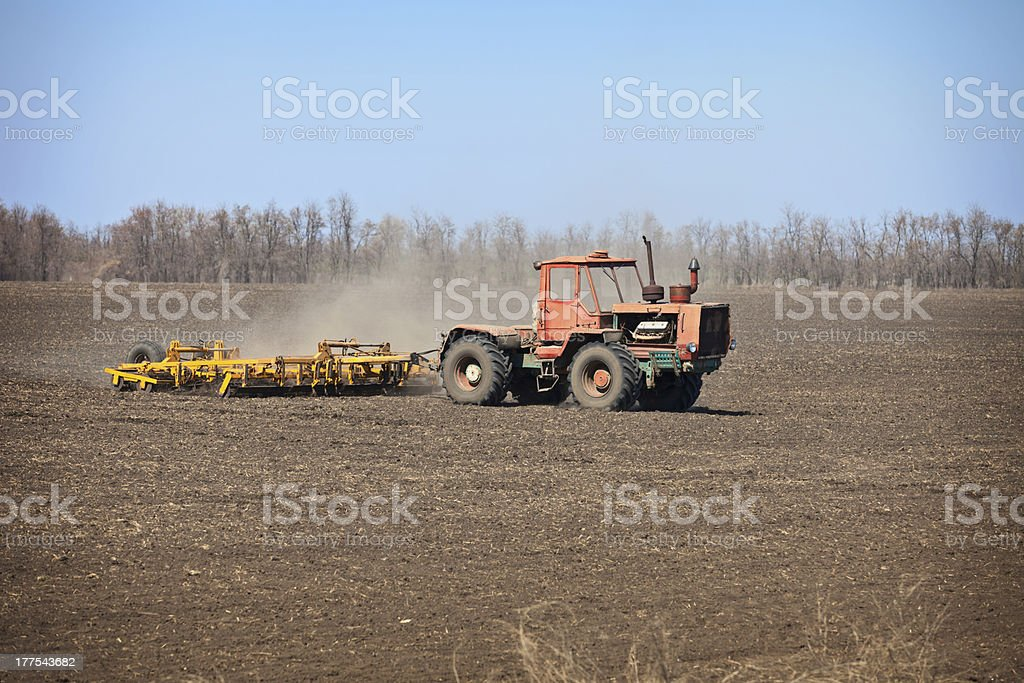 Old agricultural tractor sows royalty-free stock photo