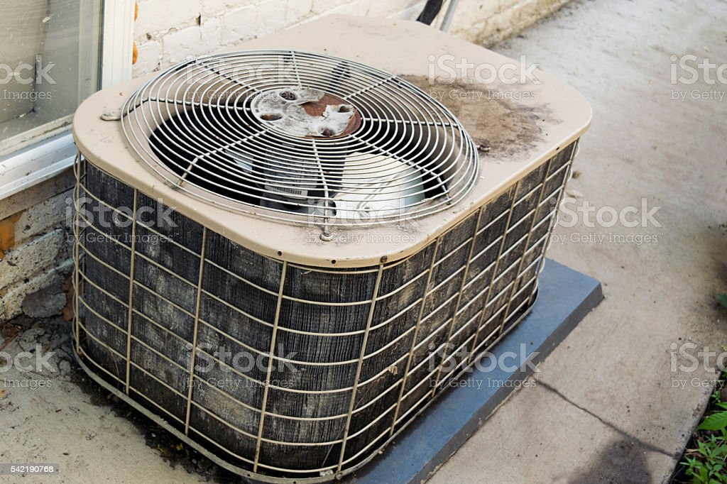 Old air conditioner unit in need of updating stock photo