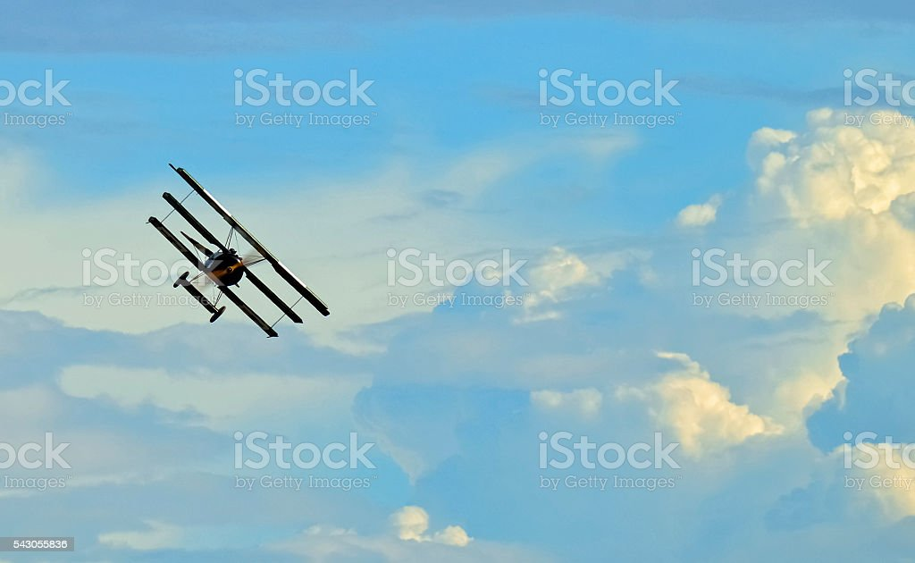 Old airplane flying on blue sky stock photo