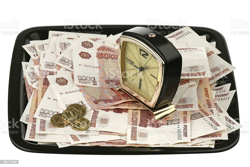 Old alarm clock and new money royalty-free stock photo