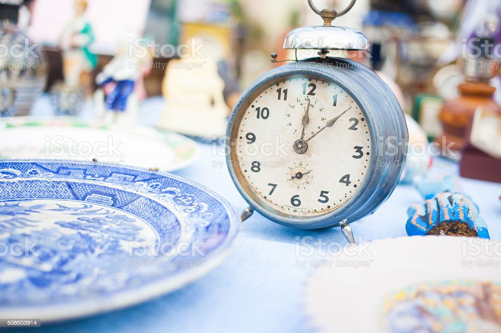 old alarm clock at a flea market stock photo