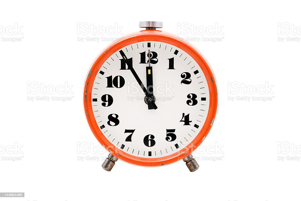 Old alarm clock isolated stock photo