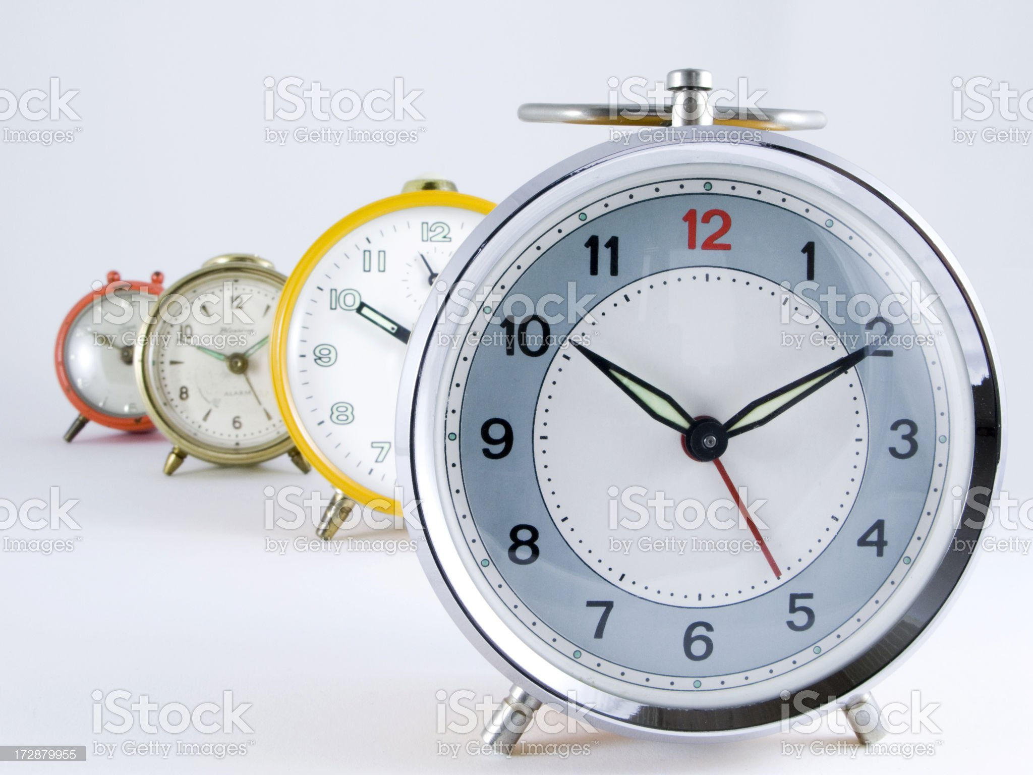 Old alarm clocks in a row royalty-free stock photo