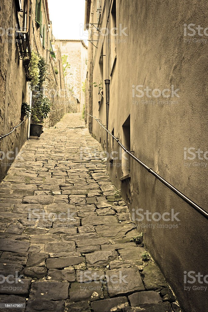 Old Alley with Steep Slope, Tuscan Village in Italy royalty-free stock photo