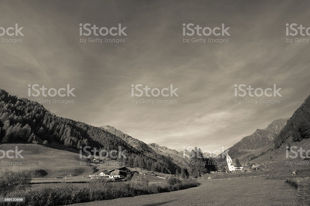 old alpine church at the end of Ahrntal valley, Italy stock photo