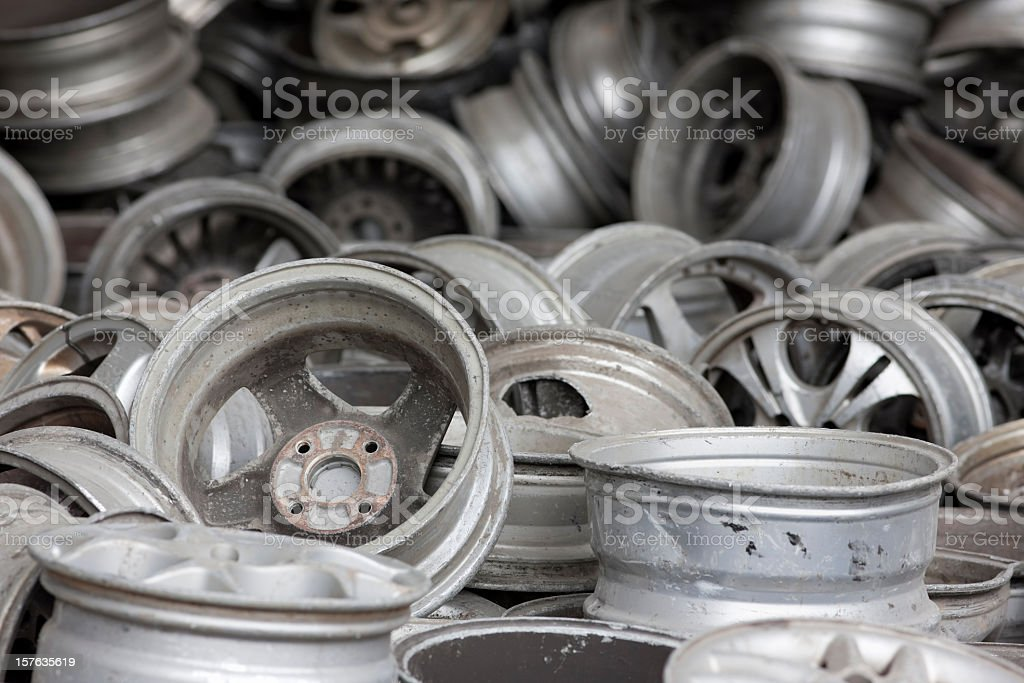 Old aluminum car wheel rims ready for recycling. stock photo
