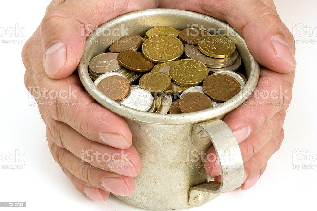 Old aluminum mug and coins. royalty-free stock photo
