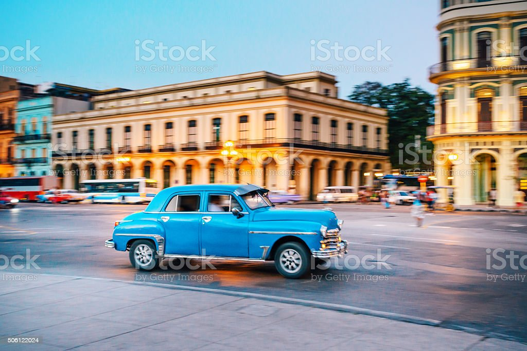 Old American car driving at a street of Havana, Cuba stock photo