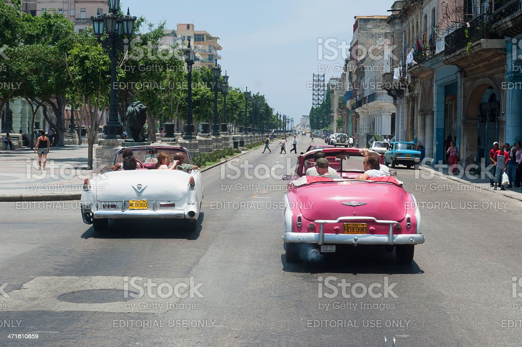 old american cars driving with tourists in Havana, Cuba royalty-free stock photo