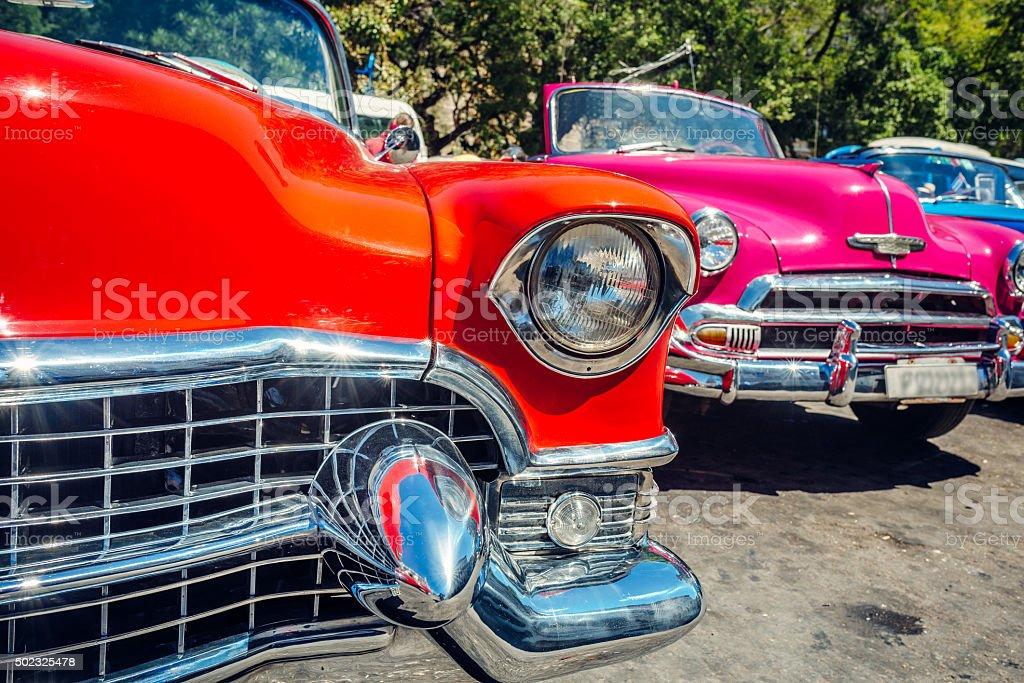 Old American cars on Havana street, near Capitolio, Cuba stock photo