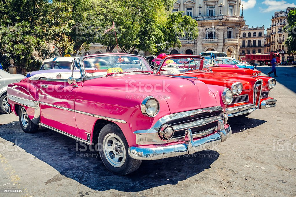 Old American cars on Havana street, near Capitolio, Cuba stock photo