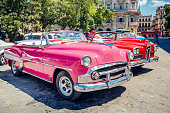 Old American cars on Havana street, near Capitolio, Cuba