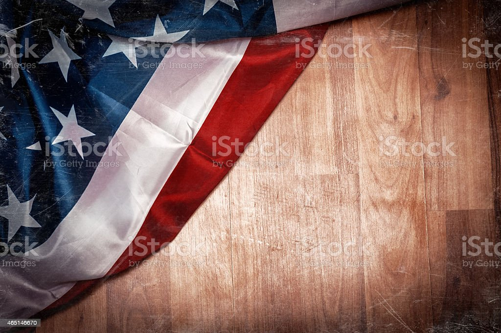 Old American flag with copy space on wooden floor stock photo