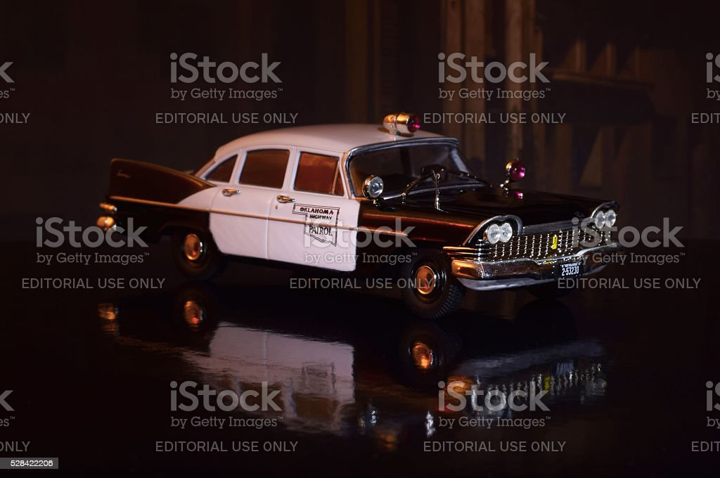 Old American police car model at night stock photo
