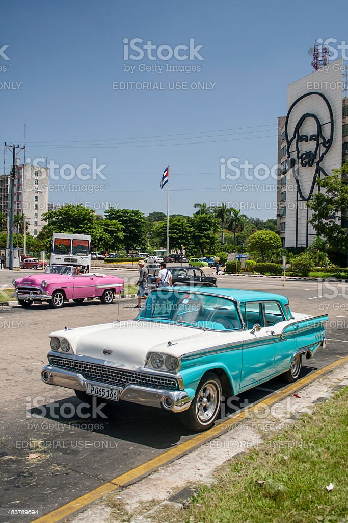 Old American Taxis Alongside Revolution Square in Havana, Cuba stock photo