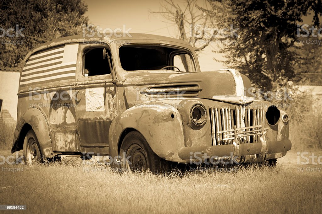 Old American van deserted rusting away stock photo