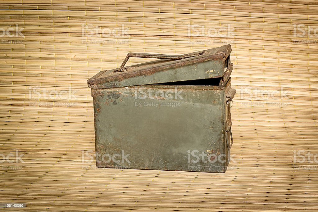 old ammunition box still life mat weave background stock photo