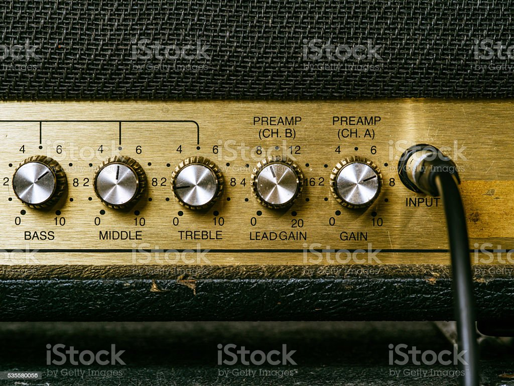 Old amplifier knobs stock photo