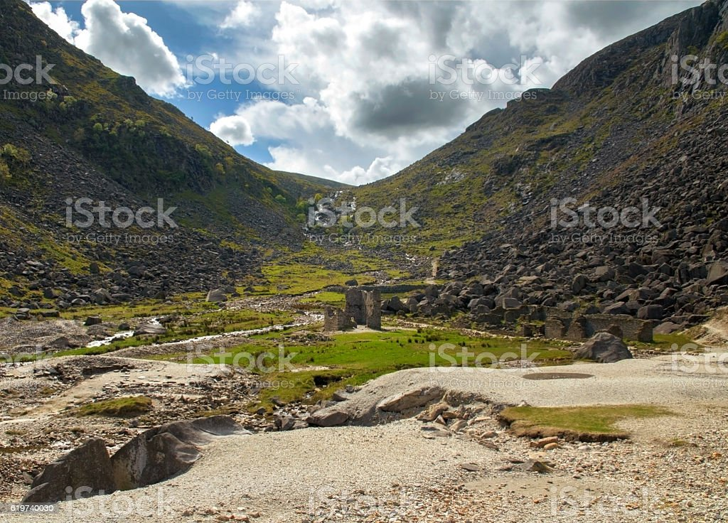 Old ancient mine with buildings Glendalough valley, Ireland stock photo