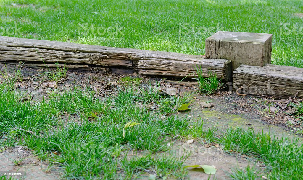 old and abandoned wooden fence in a meadow covered with stock photo