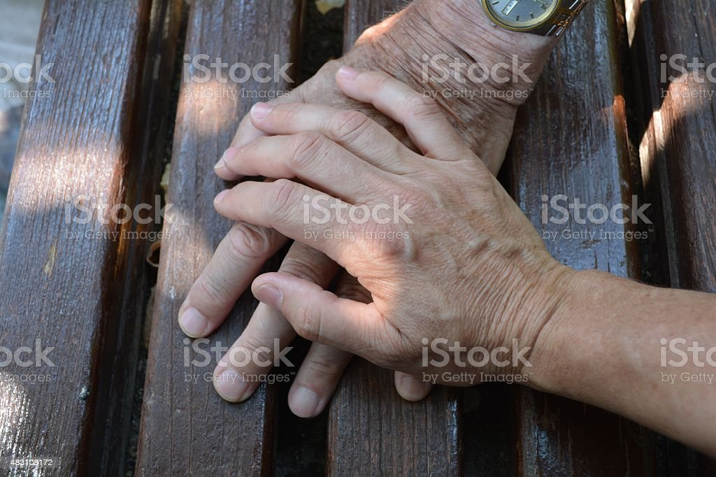 Old and Adult Hands stock photo